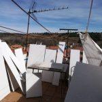Secado de cuadros en la terraza de casa